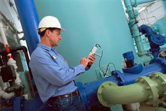 Environmental compliance engineer checking filter performance
