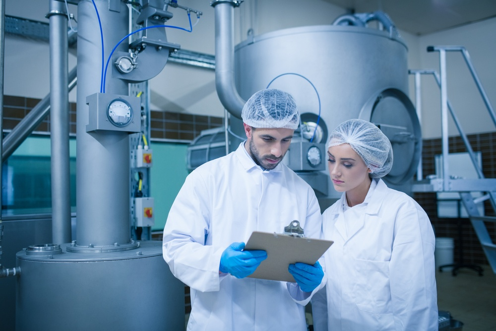 Food technicians working together in a food processing plant-1.jpeg